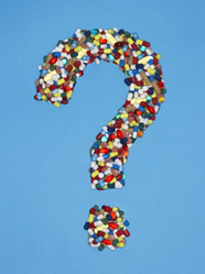 A question mark made of pills